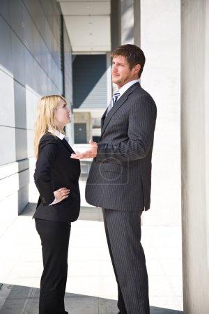 Caucasian business arguing