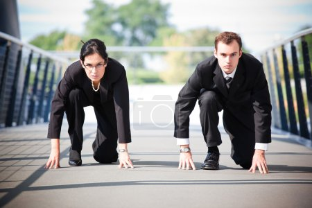 Photo for A shot of two business in a running start position competing against each other - Royalty Free Image