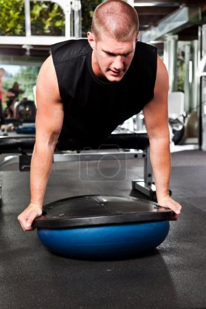 Photo for A shot of a caucasian male athlete training and doing push-up - Royalty Free Image