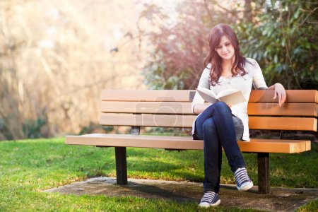 Photo for A shot of a college student reading a book - Royalty Free Image