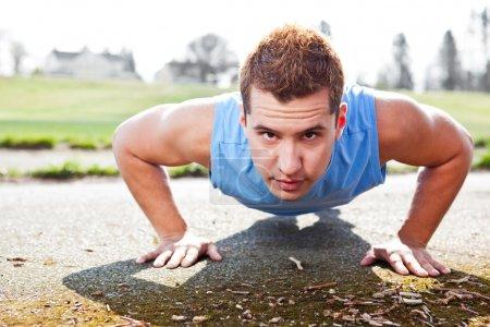 Mixed race man doing push up