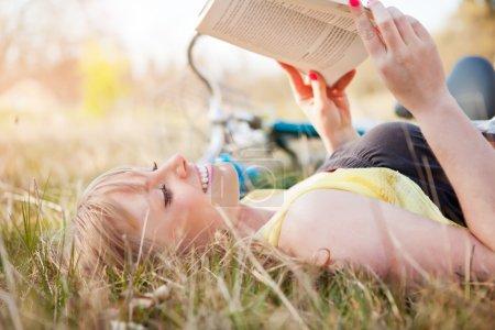 Beautiful Caucasian woman reading outdoor
