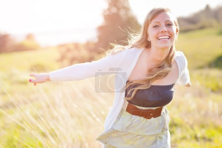 Photo for A portrait of a beautiful young Caucasian woman outdoor - Royalty Free Image