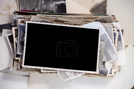 Photo for Stack of old photos with one blank photo for your image. - Royalty Free Image