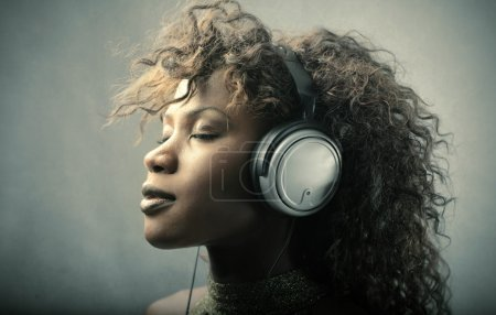Photo for African beautiful woman listening to music - Royalty Free Image