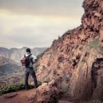Young man exploring a highland...