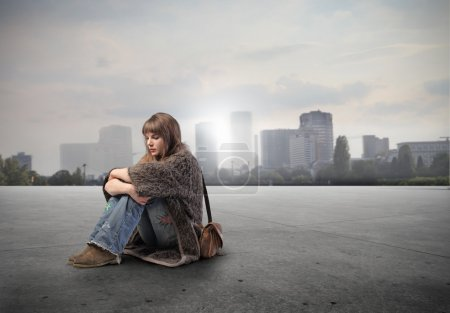 Photo for Lonely beautiful woman with cityscape in the background - Royalty Free Image