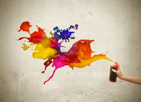 Photo for Woman's hand spraying colored paint on a wall - Royalty Free Image