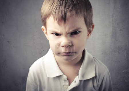 Photo for Child with angry expression - Royalty Free Image