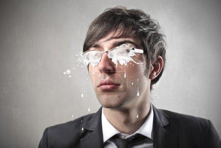 Businessman wearing eyeglasses with dirty lenses...
