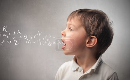 Photo for Child talking and alphabet letters coming out of his mouth - Royalty Free Image