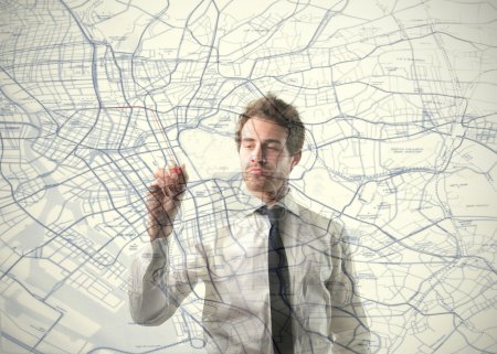 Photo for Young businessman drawing a city map - Royalty Free Image