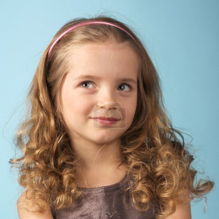 Photo for Closeup image of a curly pretty little girl - Royalty Free Image