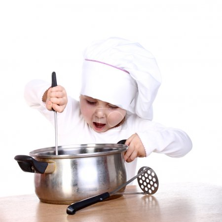 Photo for Cute happy little baby cooking something - Royalty Free Image