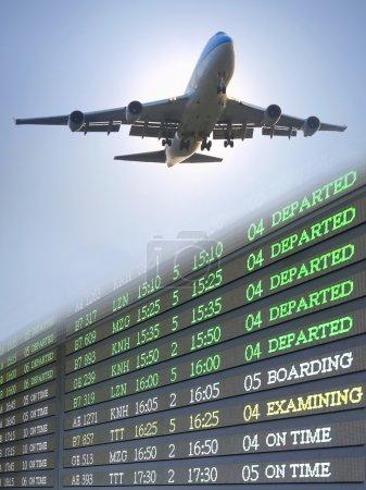 Airplane fliying over flight schedule