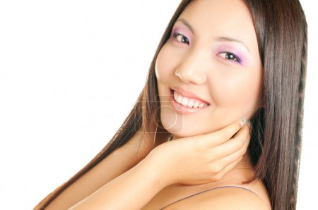 Photo for Beautiful asian woman touching her face isolated on white background - Royalty Free Image