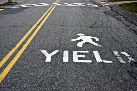 Pedestrian yield sign on a road