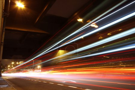 Photo for Fast moving cars at night - Royalty Free Image