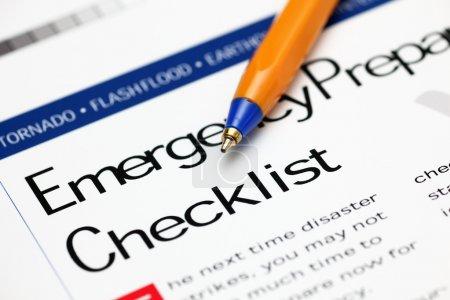 Emergency Checklist and ballpoint pen