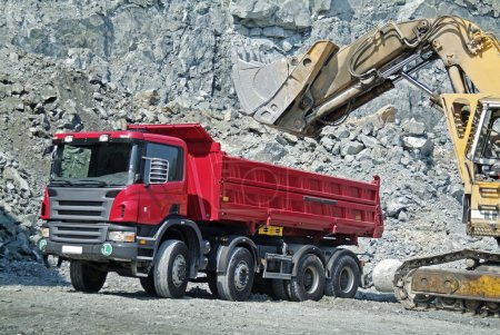 Dump Truck and Excavator in a Quarry...