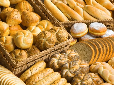Photo for Assortment of fresh bread, rolls, buns and donuts - Royalty Free Image