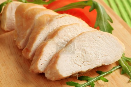 Photo for Sliced chicken breast fillet on a cutting board - Royalty Free Image