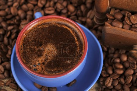 Photo for Cup of coffee and spilled out coffee beans - Royalty Free Image
