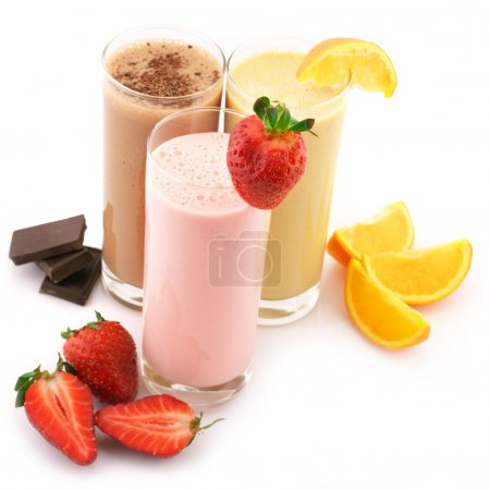 Three assorted protein cocktails with fruits isola...