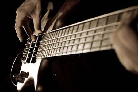 Photo for Hands of a boy playing bass guitar - Royalty Free Image