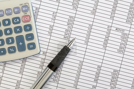 Photo for A Calculator and pen on a Spreadsheet - Royalty Free Image