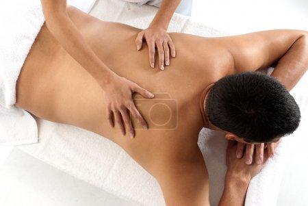 unrecognizable man receiving massage relax treatment