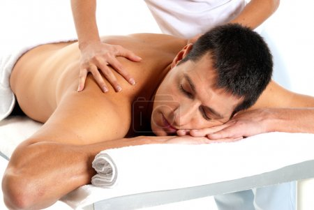 Photo for Man receiving massage relax treatment close-up from female hands - Royalty Free Image