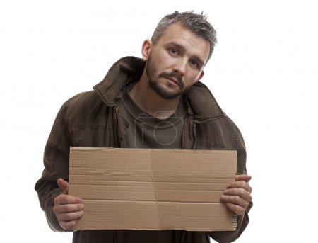 Beggar holding carton