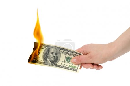 Photo for Burning dollar in hand isolated on a white - Royalty Free Image