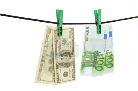 Dollars and euro hanging on a string
