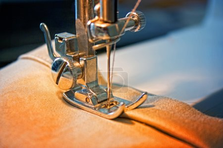 Photo for Sewing machine and item of clothing - Royalty Free Image