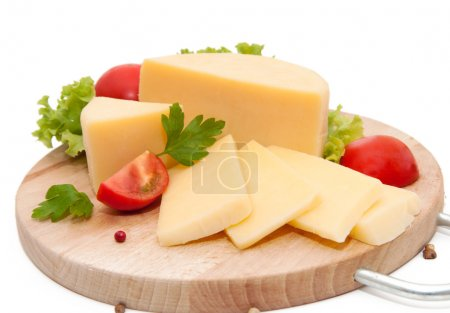 Photo for Yellow cheese with vegetables on white - Royalty Free Image