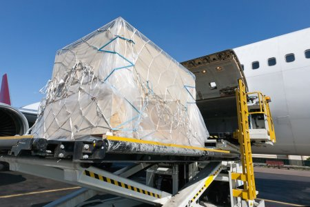 Photo for Goods are loaded on the plane - Royalty Free Image