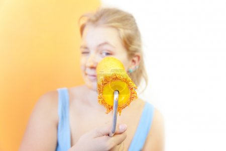 Photo for Happy young woman painting wall / Color your life / focus on the roller - Royalty Free Image