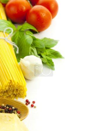 Ingredients for Italian cooking: basil, tomato, parmesan, garlic
