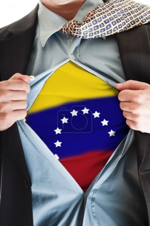 Photo pour Homme d'affaires montrant chemise drapeau venezuela - image libre de droit