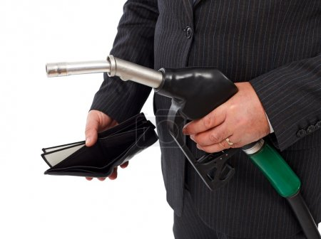 Photo for Man's hand holding gas nozzle and empty wallet. Concept of expensive gasoline and lack of money - Royalty Free Image
