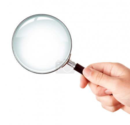 Magnifying glass in hand isolated