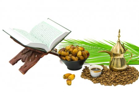 The Holy Quran and Arabic Coffee with date fruit