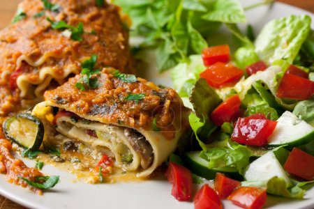 Photo for Vegan lasagna rolls with a healthy side salad - Royalty Free Image