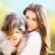 Young woman with dog outdoor day portrait...