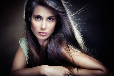 Photo for Beautiful long hair brunette woman, small amount of grain added, studio shot - Royalty Free Image