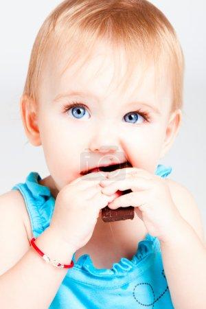 Baby girl eat chocolate