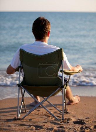 Man resting on the beach
