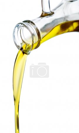 Photo for Olive oil pouring out of a bottle. Isolated on white. - Royalty Free Image